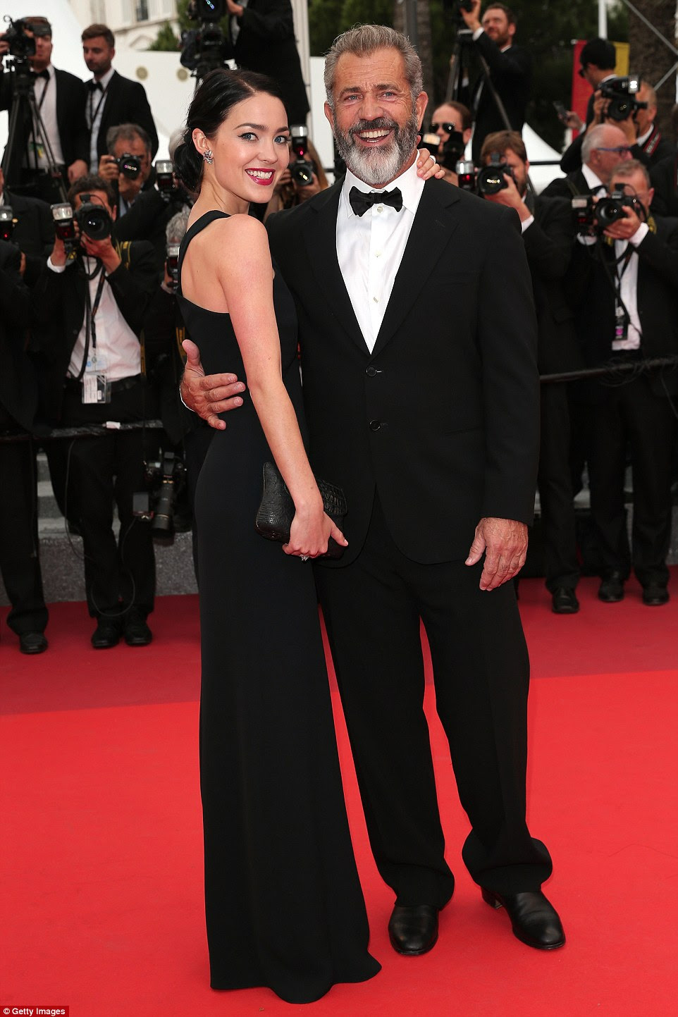 Mel Gibson, 60, and his girlfriend Rosalind Ross, 25, are clearly enjoying public displays of affection - as they proved when they attended the Cannes Film Festival Palme D'Or Award and closing ceremony on Sunday afternoon