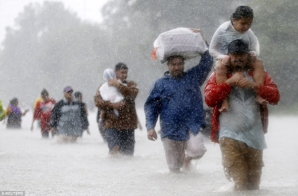 Residents wade through flood waters from Tropical Storm Harvey in Beaumont Place, Houston, Texas, on August 28. The winds and the carnage that followed reportedly left more than 20,000 children homeless in the metropolis