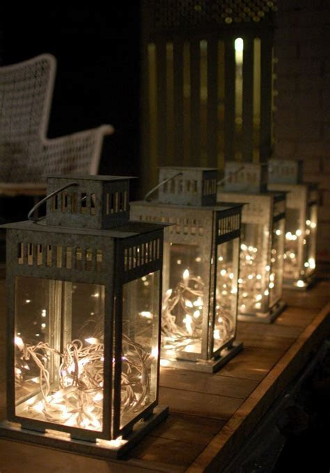 white twinkle lights / christmas lights in lanterns   diy