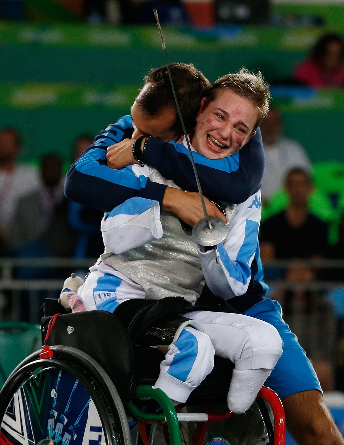 Italy's Beatrice Vio celebrates winning the bronze medal in wheelchair fencing.