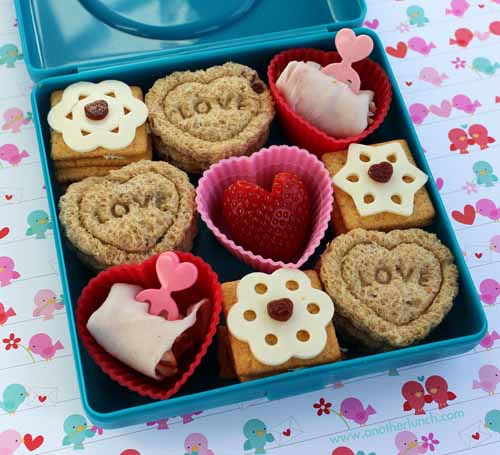 Valentine bento! Click through for 35 amazing, over-the-top Valentine's Day ideas, including Valentine's crafts, Valentine's recipes, and Valentine's decorations, and more!