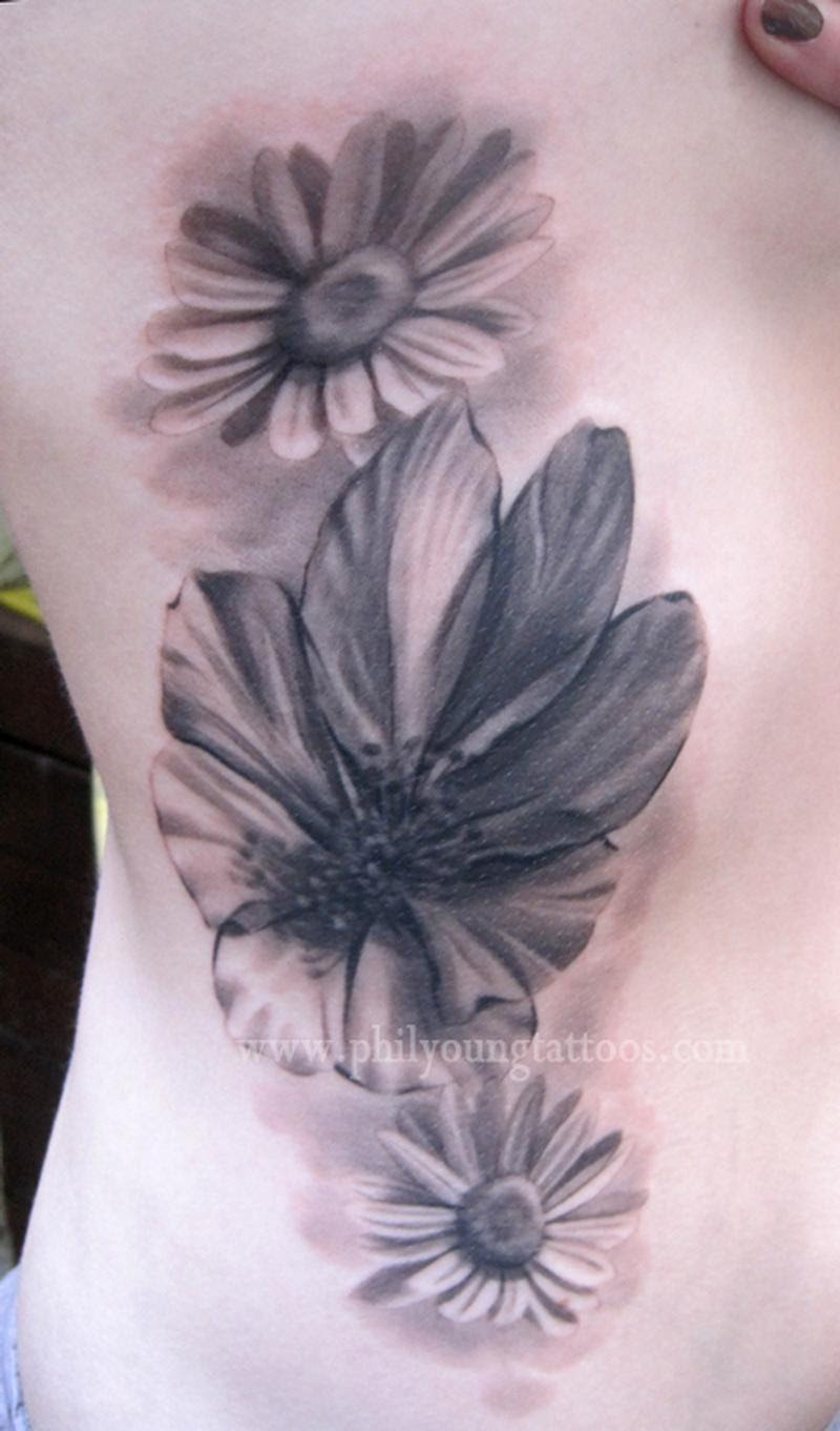 Iceland Flowers On Ribs By Phil Young Tattoonow