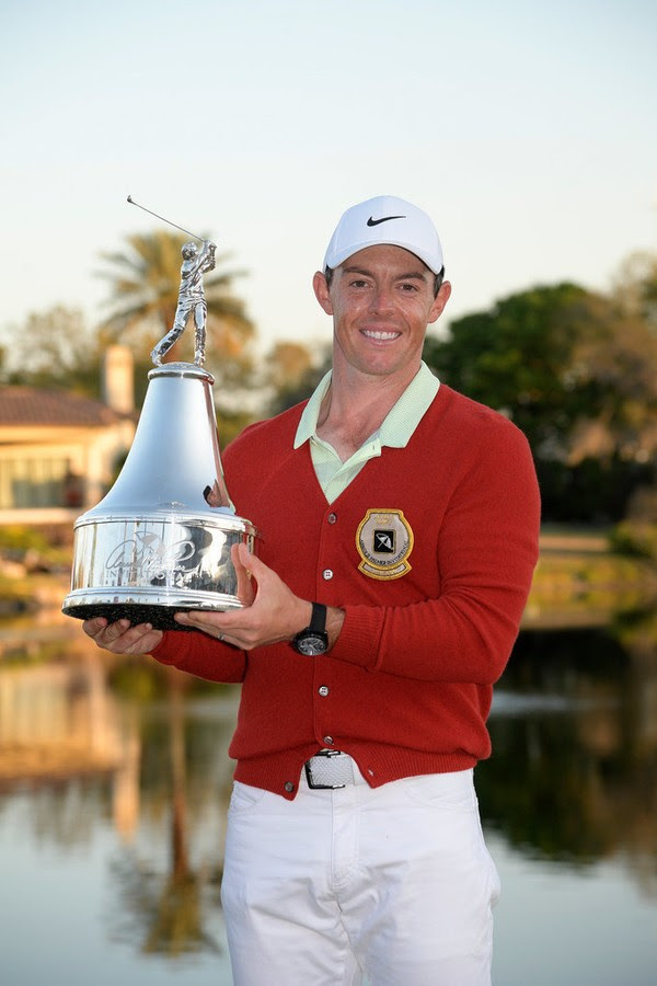 Rory with API trophy and sweater