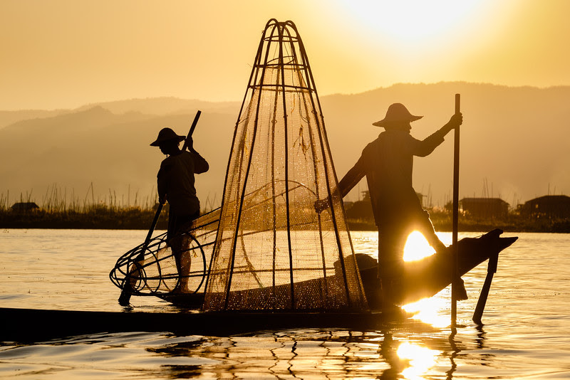 Inle lake fishermen at sunset silhouette