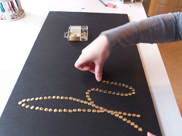 Create words with brass or silver push pins in a foam board and frame. Quick, original, affordable art.   dining space