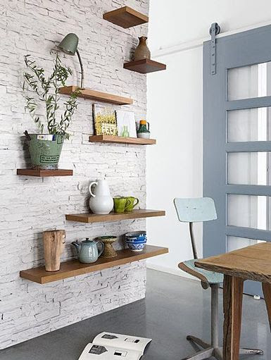 Floating wood wall shelves on brick wall | Friday Favorites on www.andersonandgrant.com