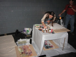 Live visual art being created around the stage...