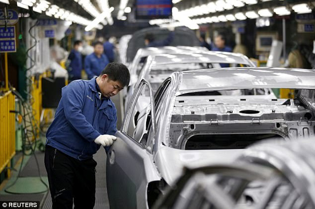 A worker works at an assembly line of Hyundai Motor's plant in Asan, South Korea on Tuesday