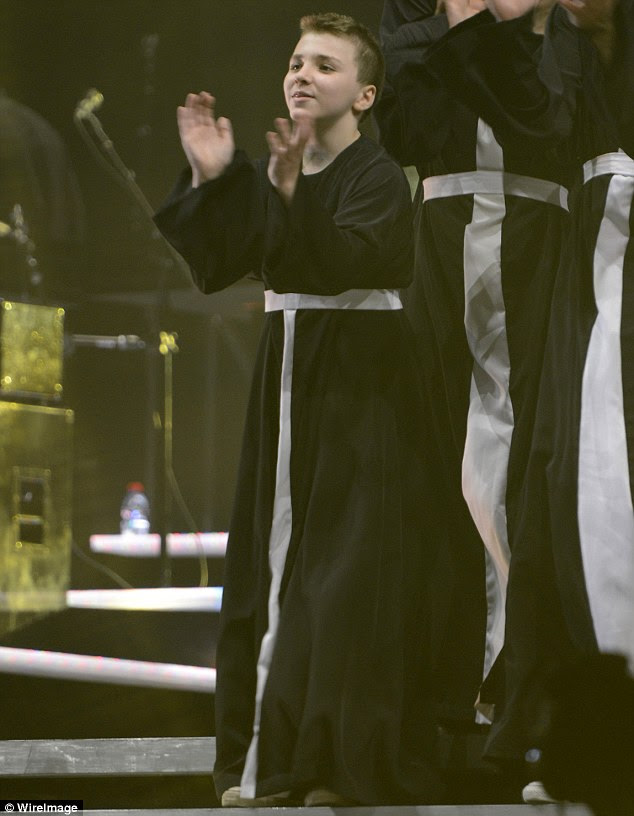 Like mother, like son: Rocco Ritchie dons a priest outfit as he joins Madonna onstage in Israel