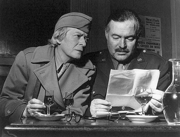 Janet Flanner and Ernest Hemingway at Les Deux Magots