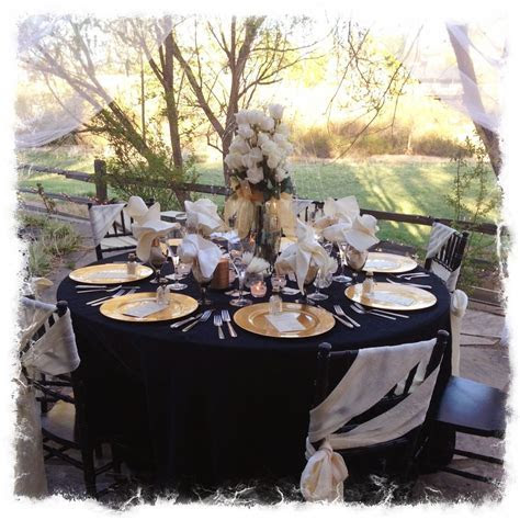 Black, Gold & Ivory anniversary party table setting