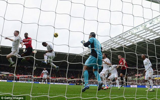 High riser: Patrice Evra heads United into the lead