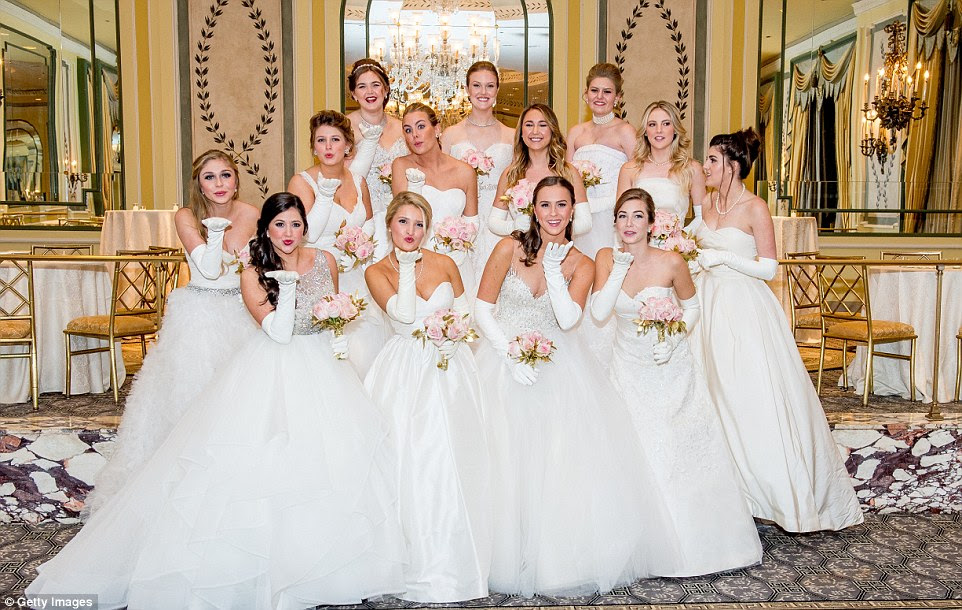 Belles of the ball: Daughters of society's elite (including, Amanda Chase Miller, front left, Brindley Elizabeth Mize, front right and Elizabeth Anne Carl, front second right) gathered for the 62nd annual Debutante Ball in New York in a myriad of white gowns at the Pierre Hotel in New York City