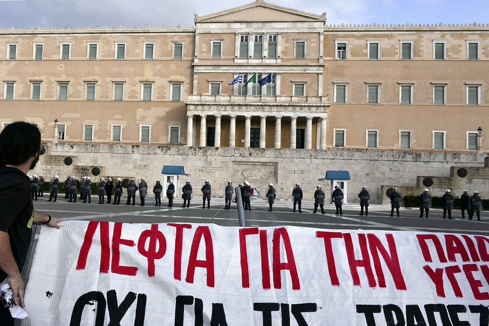 Students protest over cuts to education budgets at the Greek parliament in central Athens on Nov 6. Greece's international creditors are now urging the government to implement more austerity measures.