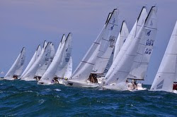 J/70s sailing off starting line
