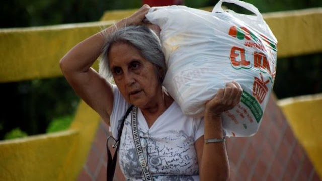 Venezuela re-opens border for Colombians to buy food