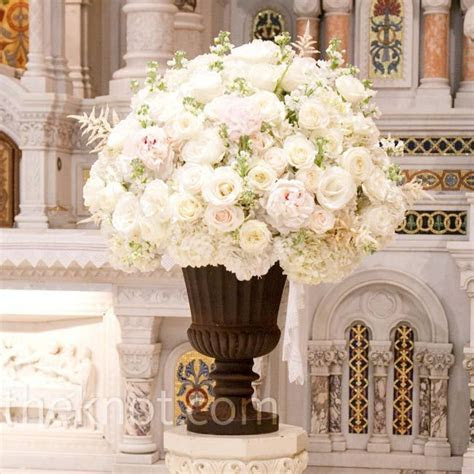 White roses, hydrangea, astilbe, and stock in a classic