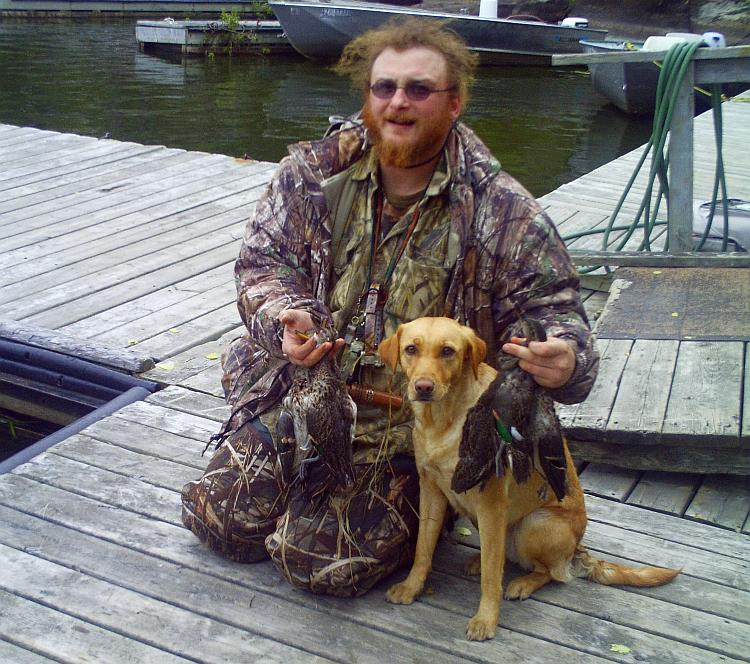 hunt,duckhunt,camo.golden retriever,dock