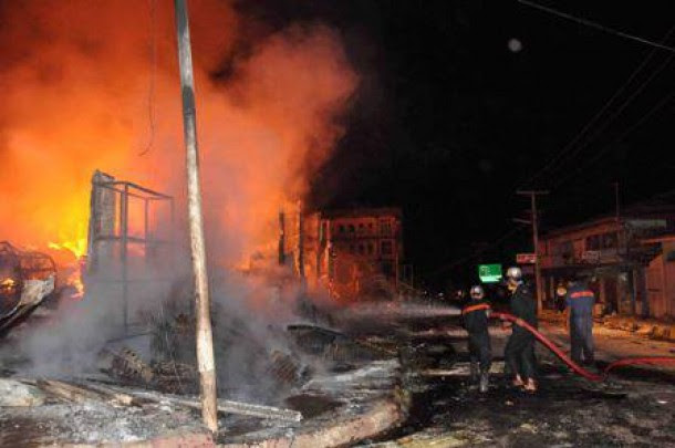 Firefighters try to put out a fire that was started by mobs during unrest in Lashio, Shan State, on Tuesday night. (Photo: Facebook/Ye Htut)
