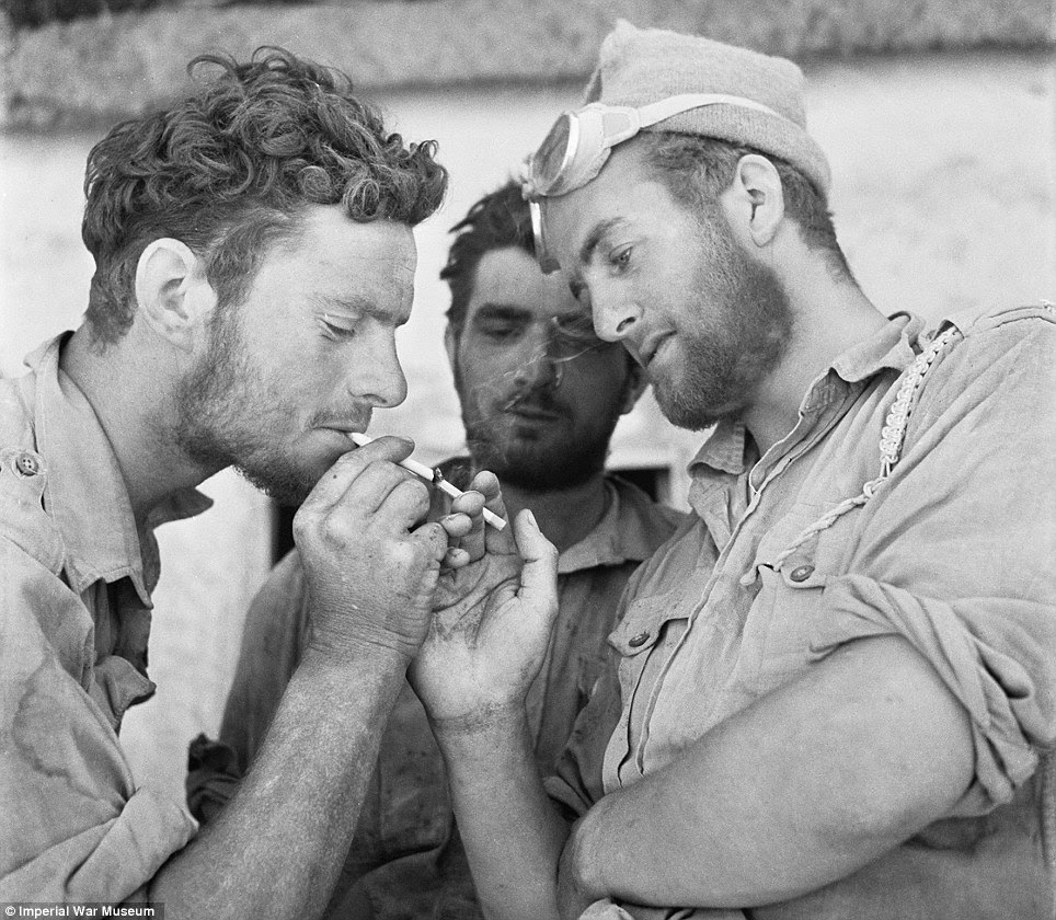 Global effort: Men of the Long Range Desert Group enjoy a moment's relaxation after returning to headquarters in, Siwa, Libya, in 1942