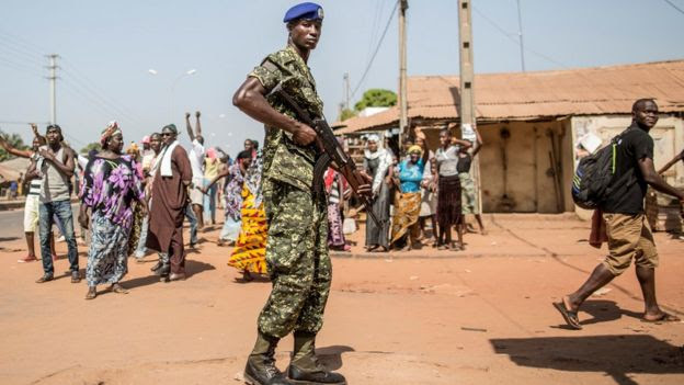 A Gambian soldier on a street in Serrekunda, The Gambia - December 2016