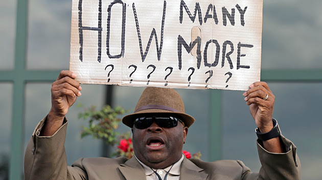 "Black man holding sign: ""How many more????"""