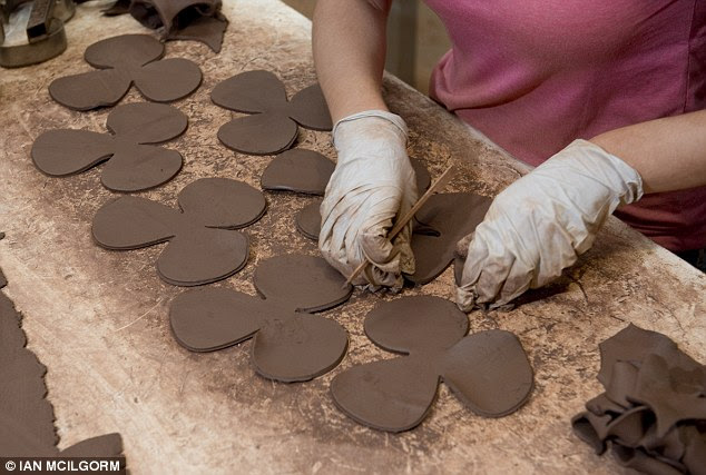 The clay petals are carefully cut out at the factory to make them look as realistic as possible
