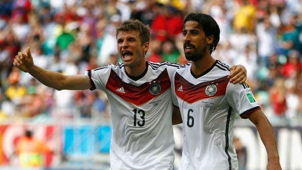 Thomas Mueller of Germany, left, celebrates his hat trick goal with Sami Khedira.