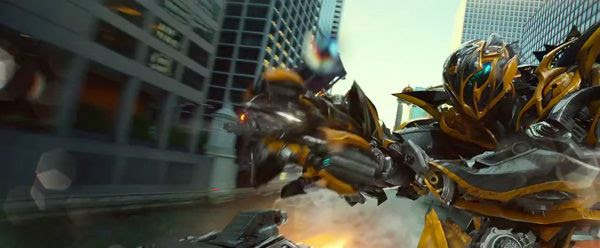 Bumblebee is chased through a city by Decepticons in TRANSFORMERS: AGE OF EXTINCTION.