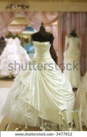 stock photo wedding dress is shown in shop window of luxury boutique