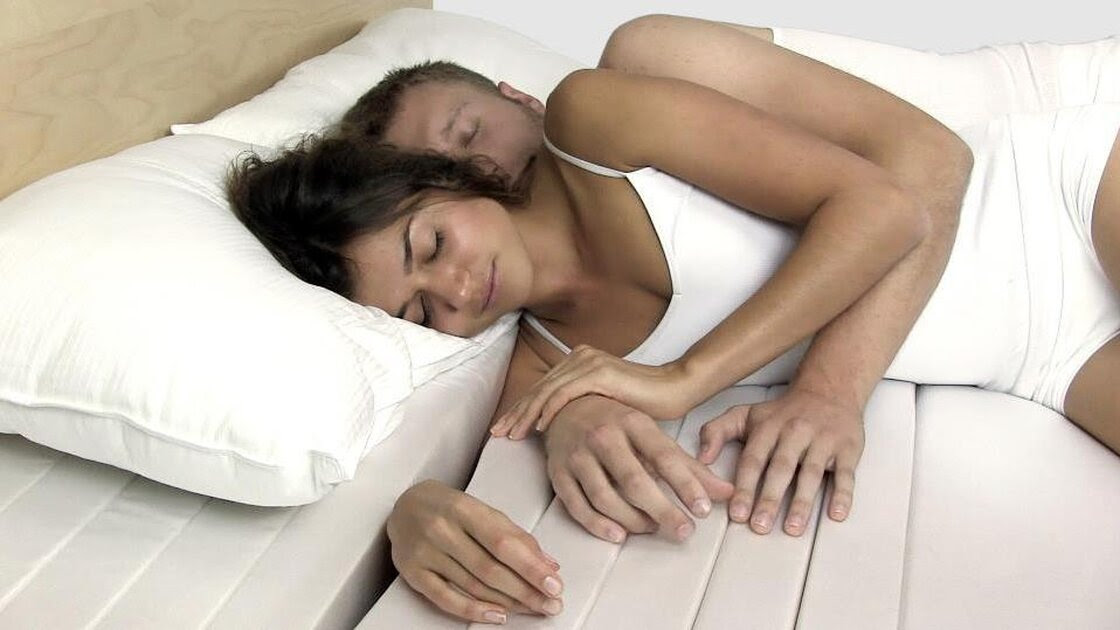 The Cuddle Mattress is divided by a series of slats. Sleepers can wedge their arm in between these slats for better snuggling.