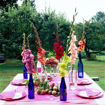 gladiolas in blue bottles