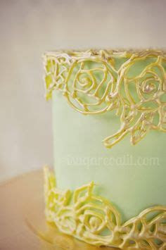 Gilded cage piped from royal icing dresses up a sage green