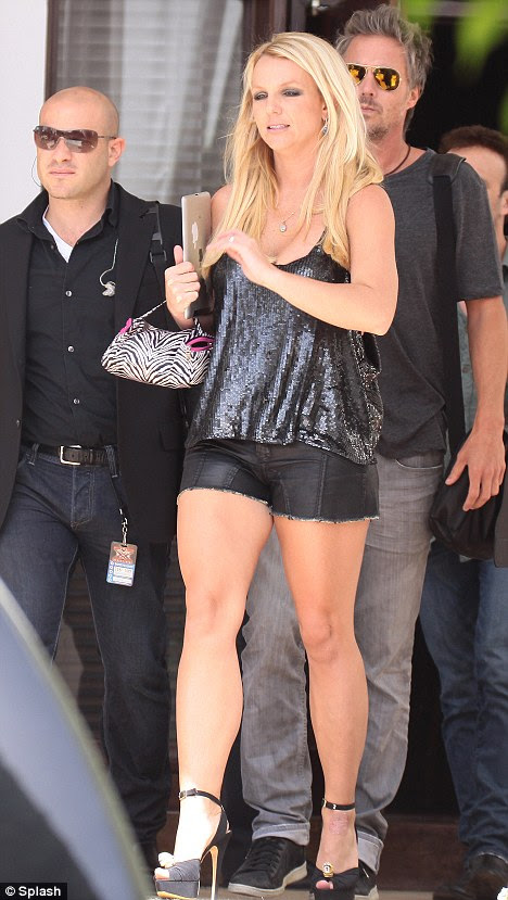 New role: Britney and her fiancé Jason Trawick (right) filming X Factor USA last month