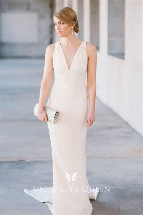 Simple & Elegant Sleeveless Ivory Satin V neckline Peplum