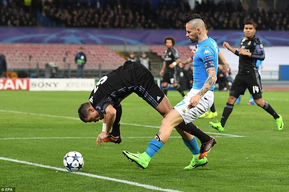 Real Madrid defender Pepe takes a spectacular tumble under pressure from Napoli midfielder Marik Hamsik
