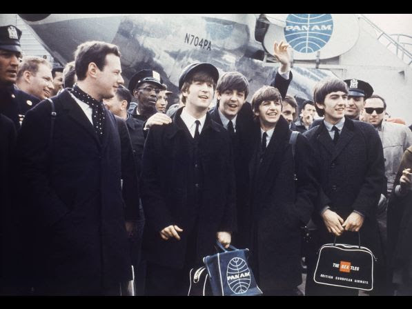 The Beatles leave London Airport, 1964. From left: manager Brian Epstein, John Lennon, Paul McCartney, Ringo Starr and George Harrison.