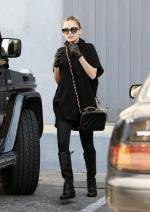 Nicole Richie wearing Modern Vintage Mack Spat Buckle Flat Boots