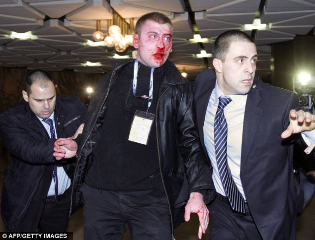 A 25-year-old man, pictured with a bloodied face after being tackled by security officials, was arrested at the scene