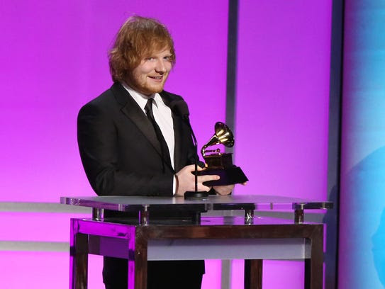 Ed Sheeran accepts the award for best pop solo performance
