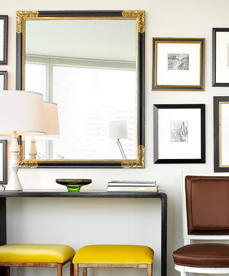 Suzie: Michael Robinson Photography - Yellow & brown chic foyer entry design with black console ...