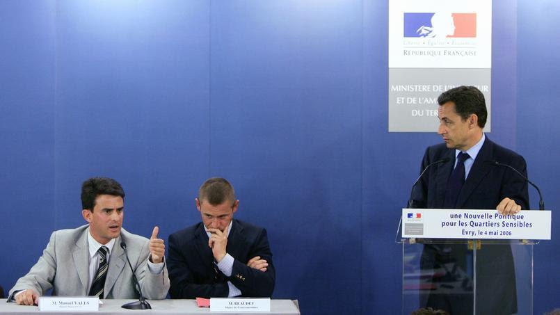 Manuel Valls et Nicolas Sarkozy lors d'une conférence sur les Quartiers Sensibles à Évry.