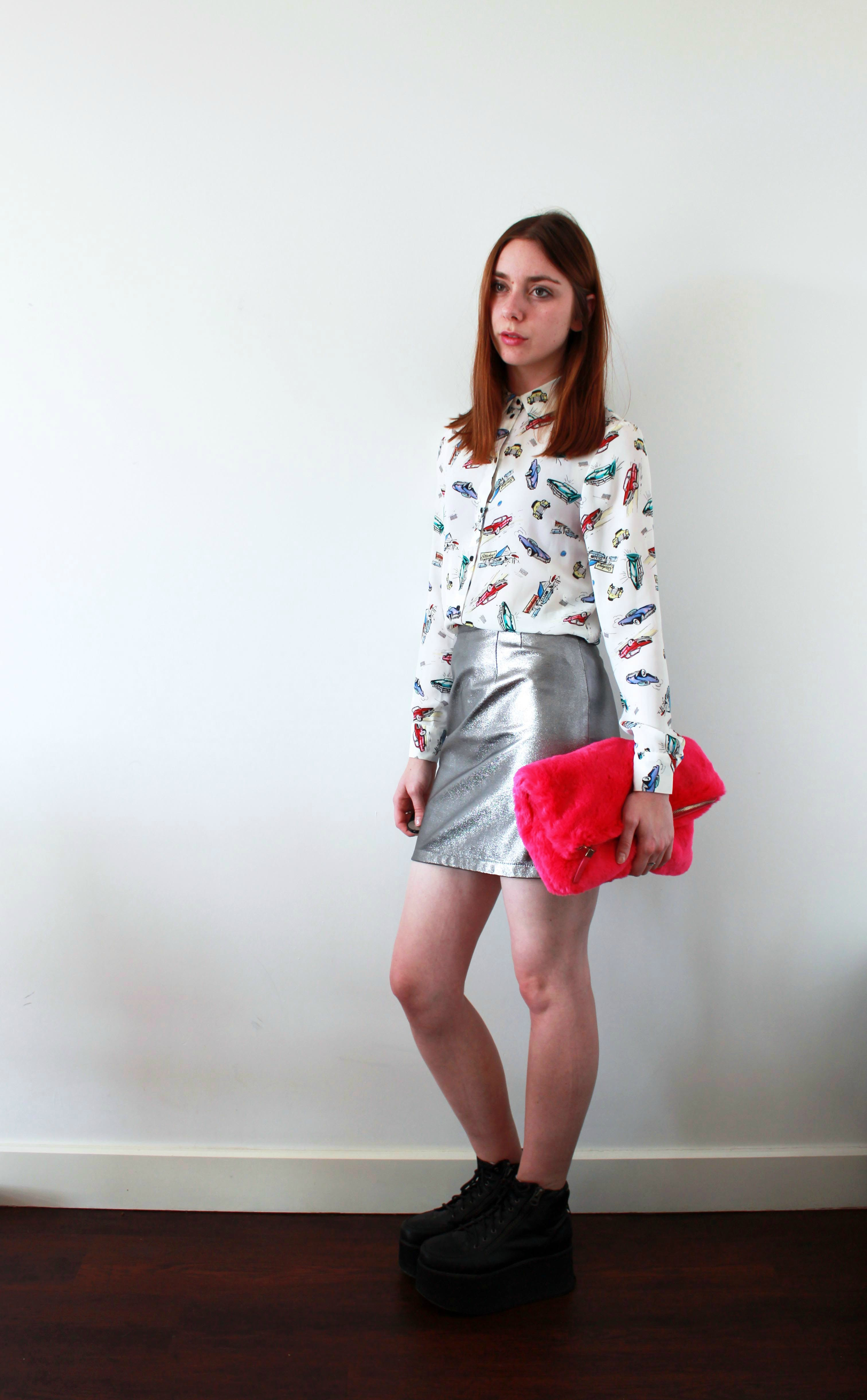 Metallic skirt, printed shirt, platforms and fur clutch outfit