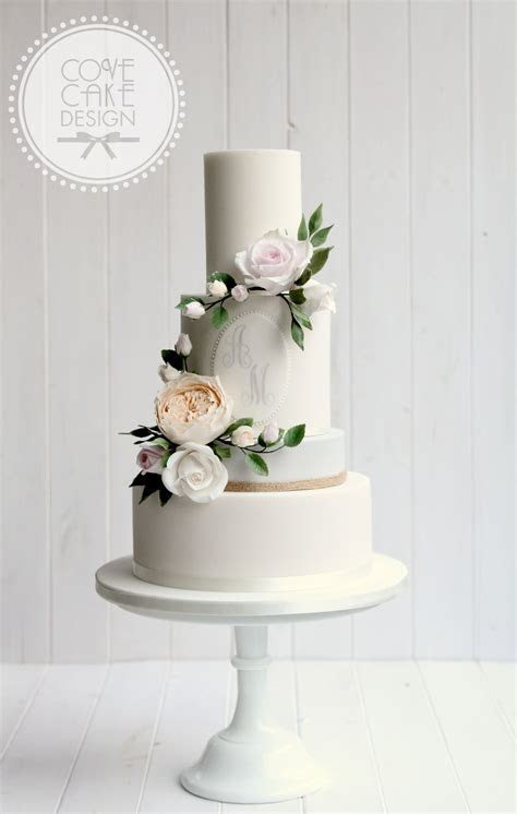 Contemporary wedding cake with custom monogram and sugar