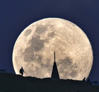 The perigee moon, or supermoon rises over Mount Eden in Auckland, New Zealand on Sunday morning.