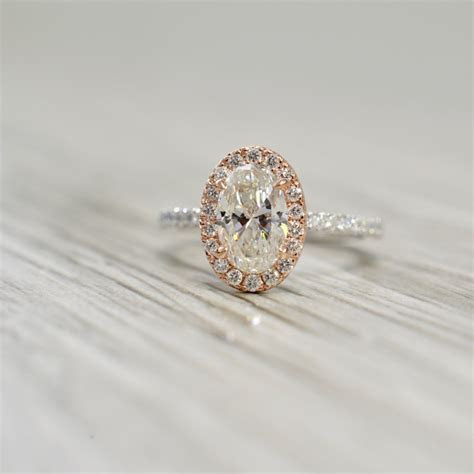 Oval Diamond in a Petite French Pavé Rose Halo & White