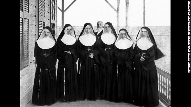 Mother Marianne, far, right, led a group of six volunteers from the Sisters of St. Francis to Hawaii to combat the health care crisis there. Their help was so welcome the Hawaiian government awarded her a medal. Behind them stands Prime Minister of the Hawaiian Kingdom.