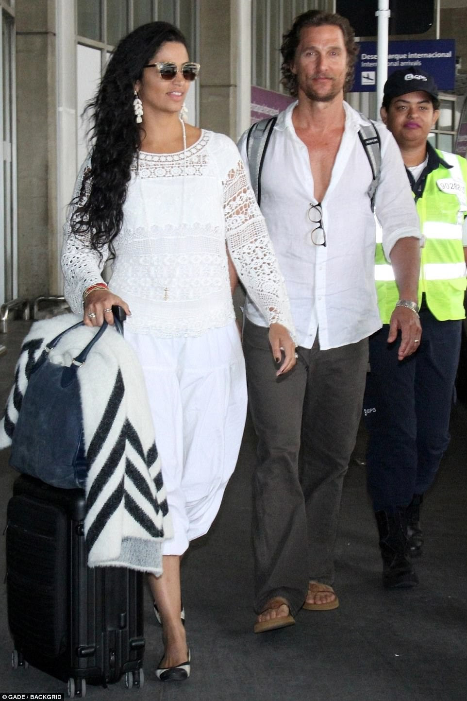 Jet-set couple: The actor and his wife Camila Alves were wearing white linen ensembles as they arrived at Rio de Janerio Airport earlier in the day