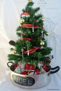 "A  mini Christmas tree nestled in a roast pot  re purposed as a base for the tree - ""The Roasted Christmas Tree""  the boondocks blog"