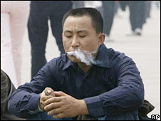 A man smokes in Beijing. File photo